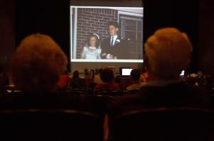 At Home Movie Day 2013, a couple view a 1960s wedding scene.