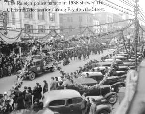 The Raleigh police parade showing the Christmas decorations along Fayetteville Street, 1938