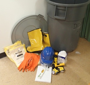 A photo showing rain boots, rubber gloves, paper and pencils, and other items from the State Archives disaster kit.