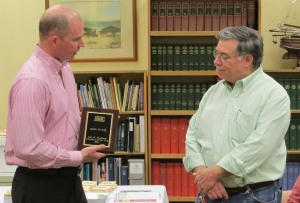 Clark Twiddy (left), chairman of the Friends of the Outer Banks History Center, presents the Lois W. Bradshaw Volunteer of the Year Award to John M. Havel.