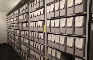 Photograph of collections housing and storage in the Archives stacks.