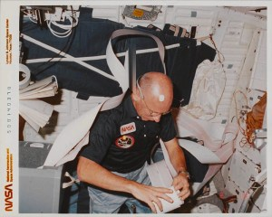 photograph is of William E. Thornton conducting research on the Challenger Space Shuttle