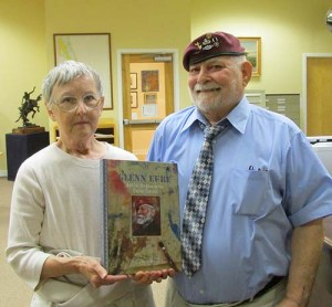 Glen and Pat Eure hold a copy of the book recently donated to the OBHC