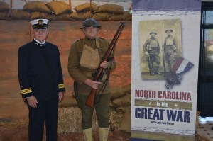 local volunteers and re-enactors Si Harrington and Jay Callaham in uniforms representing a WWI Navy Chaplain and a WWI US Army MP
