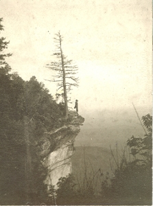 Photograph of Dr. Chase Ambler, nature enthusiast, stands on a cliff in 1910. From the Appalachian National Park Association, General Records, Western Regional Archives.