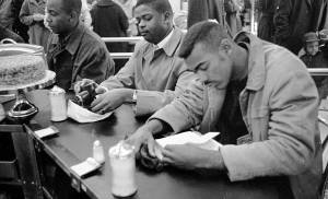 African American men seated at lunch counter, 1960.  [Call no. NO.2.10.1960.fr6a]