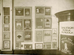 Handmade poster display for a war savings stamp drive during WWI by schoolchildren of the Uncle Sam War Savings Stamps Society at Murphey School, Raleigh Public Schools