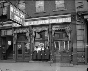 Western Union employees are seen posing in front of their workplace on Fayetteville Street in Raleigh c. 1915