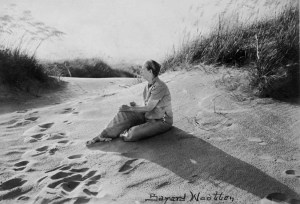 Bayard Wootten posing near sand dunes at Nags head, NC,