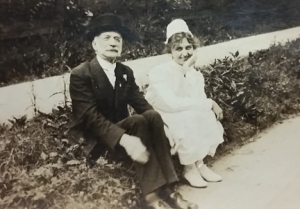 Ella McKay, RN, with a Confederate veteran at the Old Soldiers Home in Raleigh, North Carolina, ca. 1917