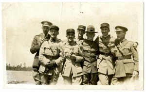 Seven smiling French and American soldiers