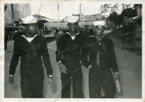 Photograph of Lawrence E. Allen (center) and two unidentified African American shipmates in Sweden