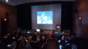 Attendees watching a Home Movie Day event