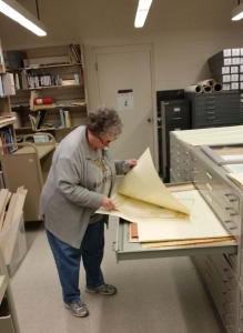 Donna working with maps at the OBHC