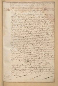 A page of handwritten text of Court minutes for men accused of storing Blackbeard's booty.