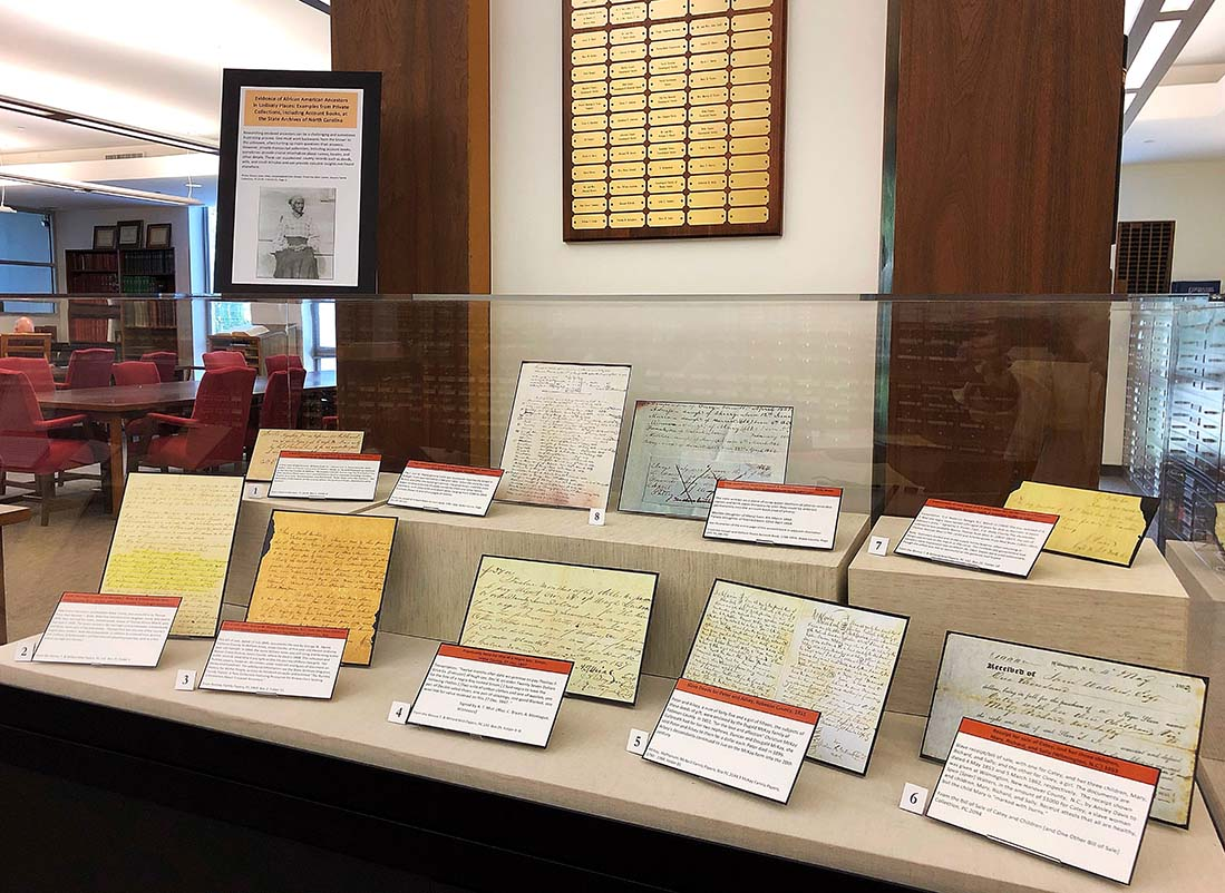Photo of the exhibit case in the Search Room with facsimile documents on display.